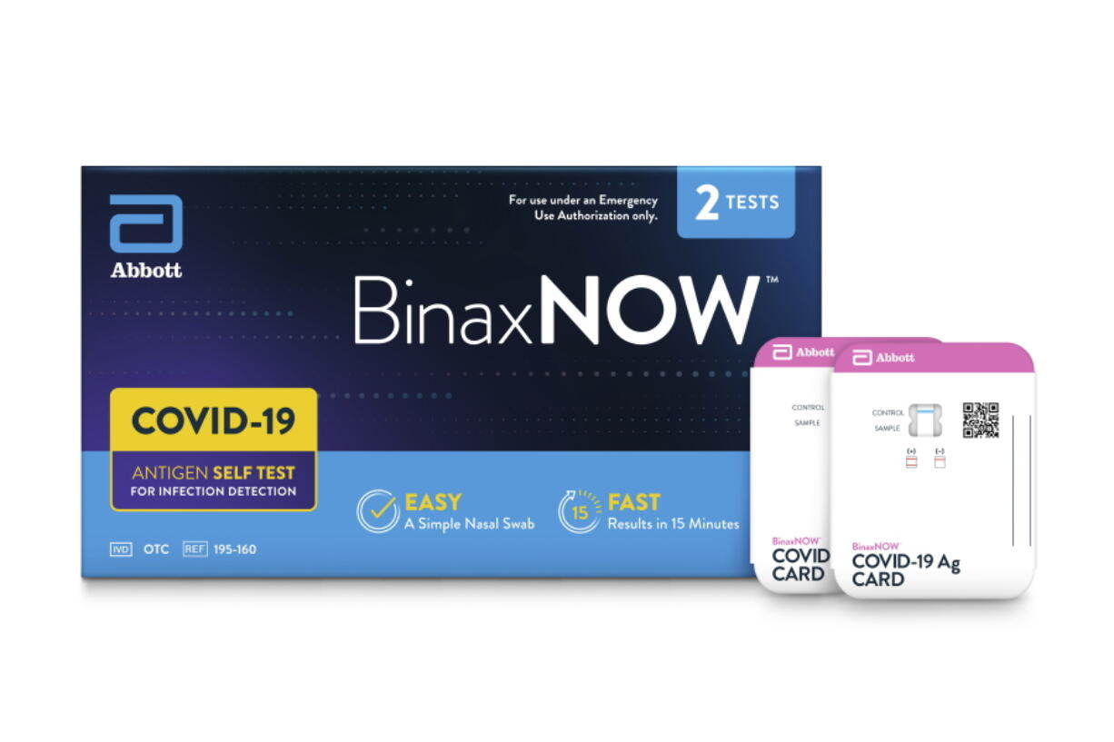 This image provided by Abbot in September 2021 shows packaging for their BinaxNOW self test for COVID-19. President Joe Biden is betting on millions more rapid, at-home tests to help curb the latest deadly wave of the COVID-19 pandemic, which is overloading hospitals and threatening to shutter classrooms around the country. But the tests have already disappeared from pharmacy shelves in many parts of the U.S., and manufacturers warn it will take them weeks to ramp up production, which was slashed after demand for the tests plummeted over the summer of 2021.