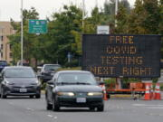 A sign directs motorists to a COVID-19 testing site, Wednesday, Sept. 22, 2021, in Tukwila, Wash., south of Seattle. (AP Photo/Ted S.