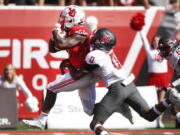 Utah running back TJ Pledger (5) runs for a touchdown as Washington State defensive back Jaylen Watson (0) tries to tackle him in the second half, of an NCAA college football game Saturday, Sept. 25, 2021, in Salt Lake City.