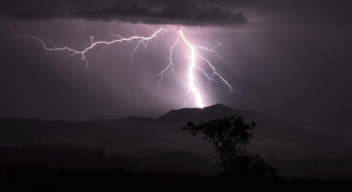 Lightning strikes over Mt. St. Helena Thursday, Sept. 9, 2021 in Napa county, Calif.   Northern California was hit with well over 1,000 strikes during the storm.  Fast-moving thunderstorms with lightning and little rain are moving across Northern California and raising the risk of new wildfires in the drought-stricken region.