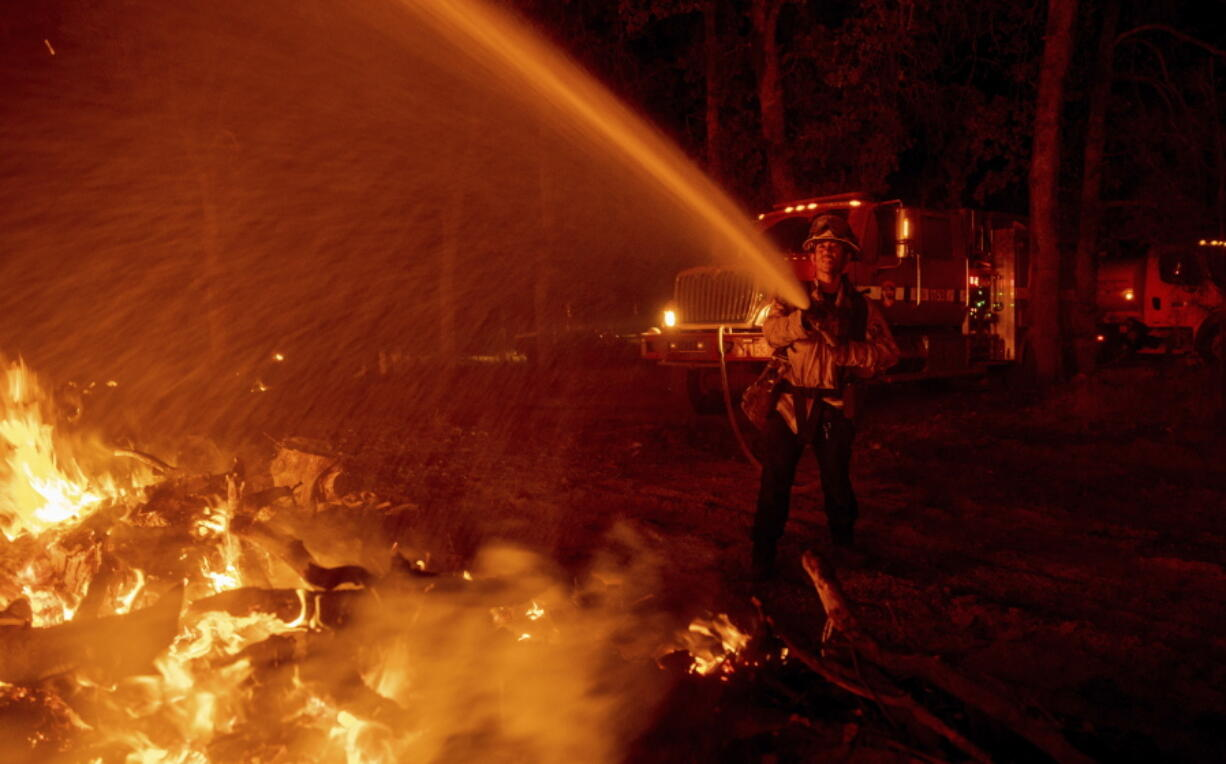 Firefighter Ron Burias battles the Fawn Fire as it spreads north of Redding, Calif. in Shasta County, on Thursday, Sept. 23, 2021.