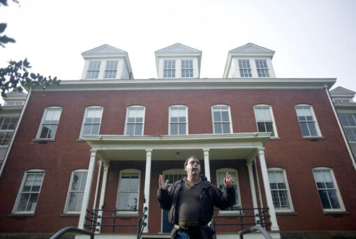 Historian and author Jeff Davis tells a story about spending the night in the haunted Post Hospital in Fort Vancouver during the Spirit Tales Walking Tour in 2016. (The Columbian files)