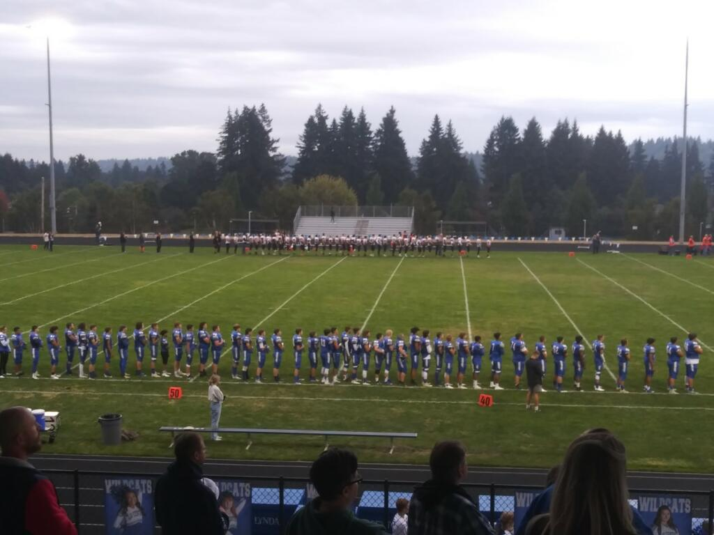 Kalama and La Center players line up for the national anthem before their game on Friday Sept.