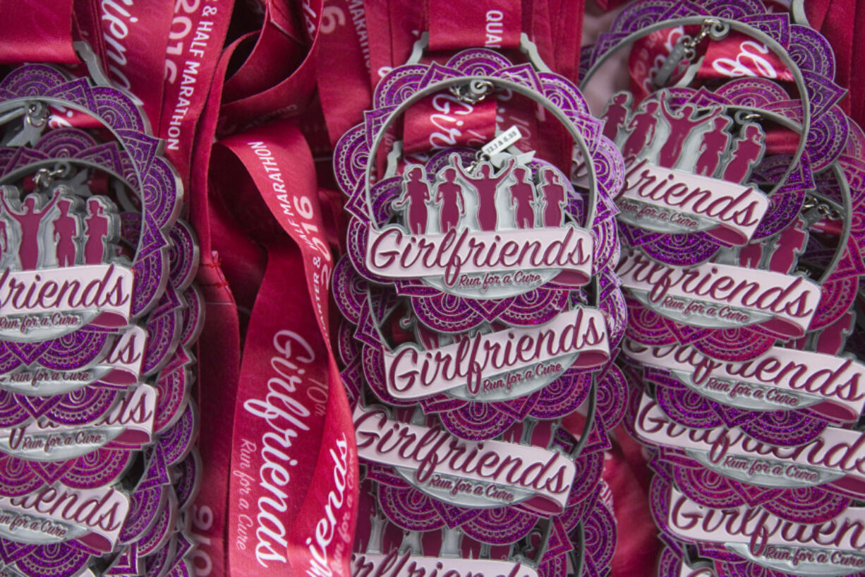Medals are ready to award to participants of a previous Girlfriends Half Marathon in Vancouver. The 15th edition of the race is set for Sunday, starting and finishing at the Vancouver Waterfront.