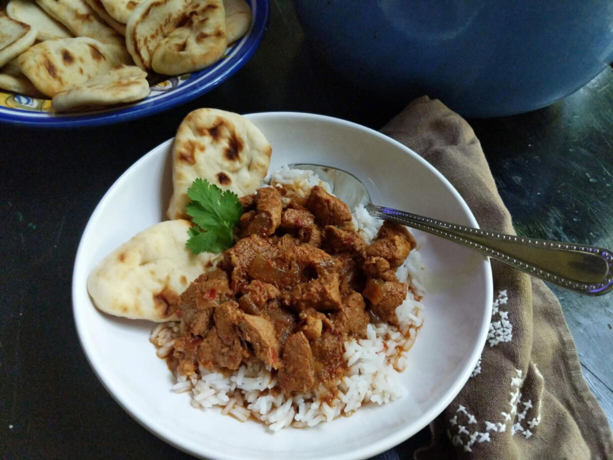"""""""Vindaloo"""" usually conjures up a searingly hot curry, but this recipe is relatively mild. It's made with pork butt and dried guajillo chiles."""