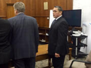 Dean Imokawa of Battle Ground takes in the news of a guilty verdict in his vehicular homicide trial in January 2017.