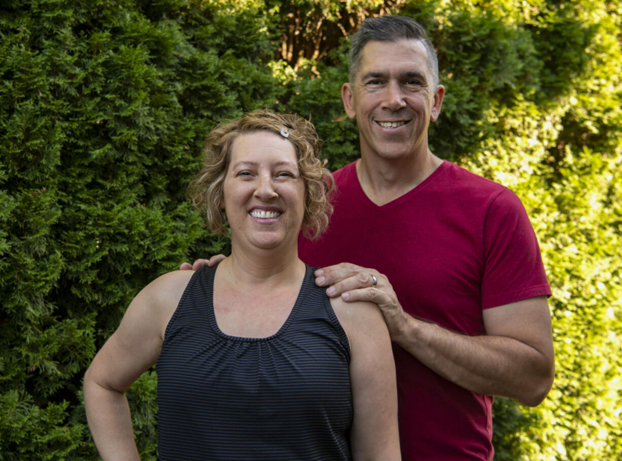 Amy Hawkins and Ben Novinger, here at their Portland home, are part of OHSU's Knight Cancer Institute trial program called Exercising Together.