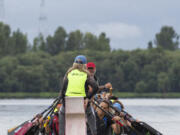 The Catch-22 dragon boat team, which includes a subdivision of breast cancer survivors, practices in August at Vancouver Lake.