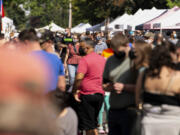 """Mostly masked guests crowd the streets at the Vancouver Farmers Market on Sept. 4 in downtown Vancouver. After <a href=""""https://www.columbian.com/news/2019/oct/29/vancouver-farmers-market-sets-record/"""">its most popular year in 2019, when an estimated 420,000 people visited the market</a>, it had in 2020 a major dropoff due to the pandemic and its restrictions, but the 2021 season has had about 170,000 shoppers visit so far this year."""