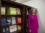 Susan Stearns stands near the book bank at Pink Lemonade Project's downtown Vancouver offices. She took over as CEO of the nonprofit as the pandemic hit in March 2020 and has guided an expansion of programs. Participation increased 30 percent during the pandemic.