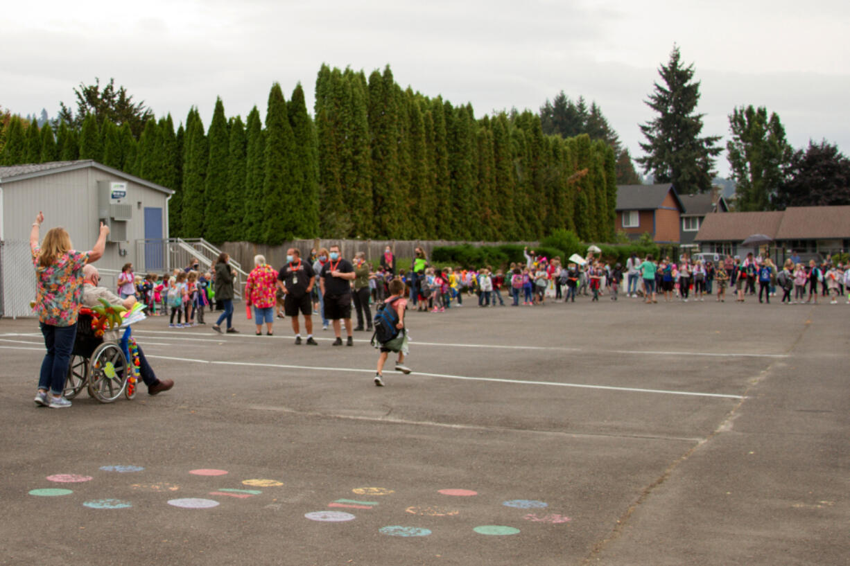 Woodland: Students and staff at North Fork Elementary School celebrate head custodian Ed Sorensen's retirement with a celebration tunnel.