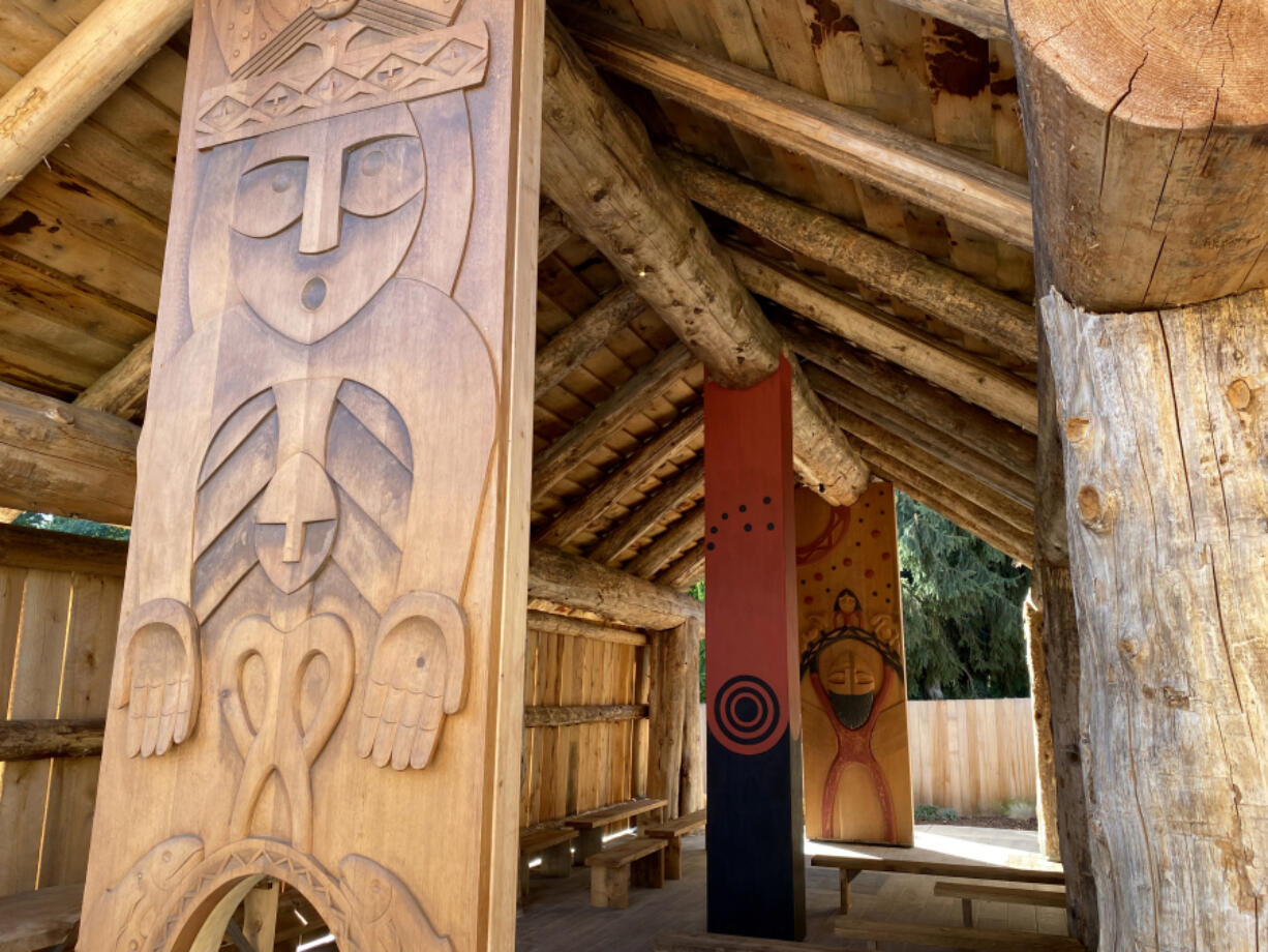 The Gathering Place at Washuxwal pavilion at the Two Rivers Heritage Museum. The open pavilion design is inspired by traditional cedar plankhouses used by local tribes living along the shores of the Columbia River. It features Native-inspired wood carvings created by Adam McIsaac, project lead carver and adviser for the pavilion artwork, a respected expert in Native American art.