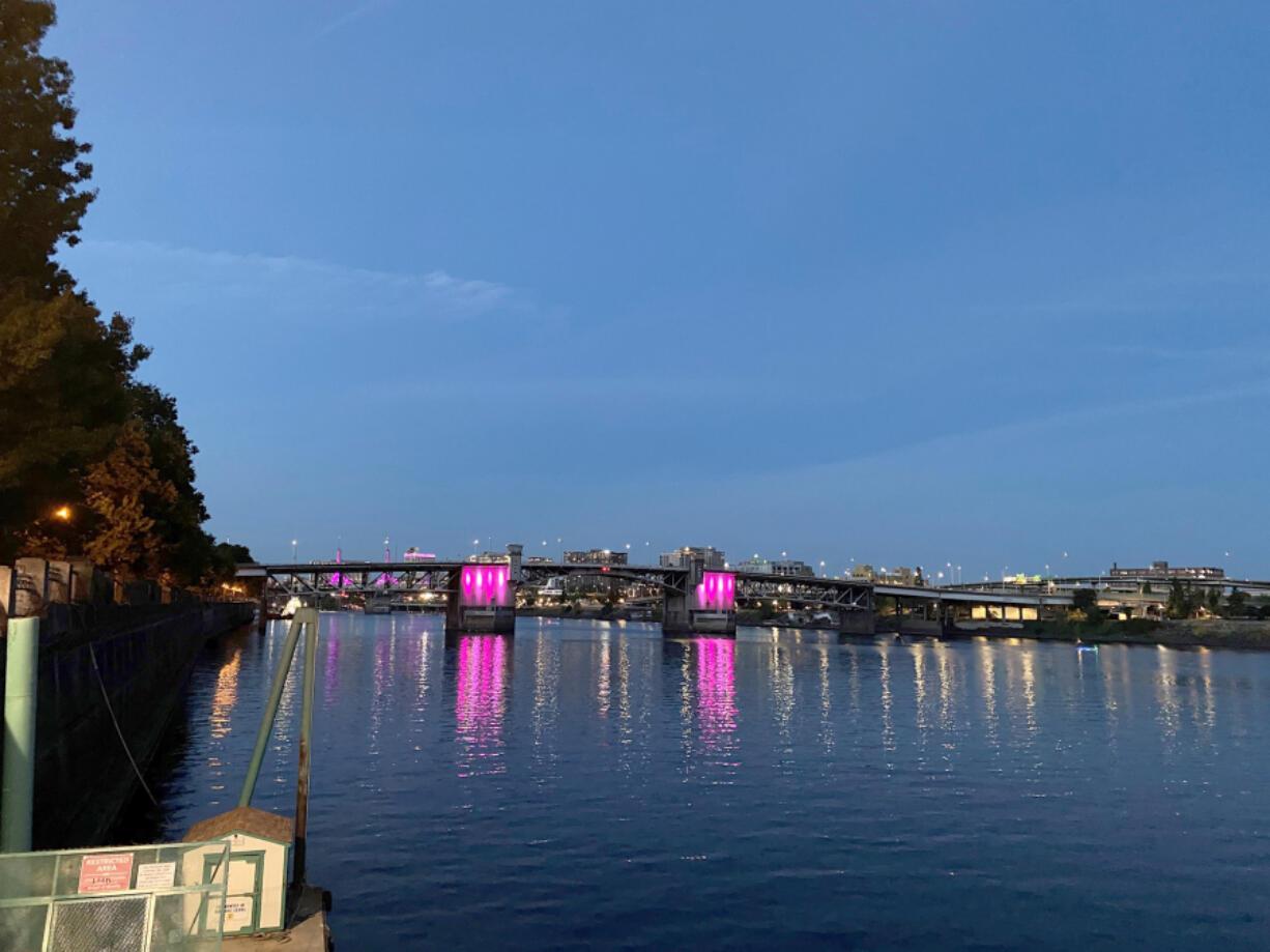 Breast cancer awareness groups turned Portland's Morrison Bridge pink to kick off Breast Cancer Awareness Month.