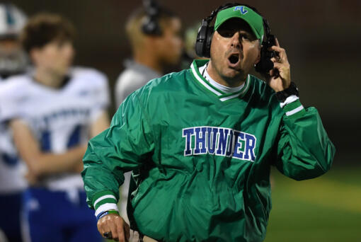 Mountain View head football coach Adam Mathieson yells toward the sideline Friday, Oct. 15, 2021, during the Thunder's 17-14 win against Prairie at Battle Ground High School. (Taylor Balkom/The Columbian)