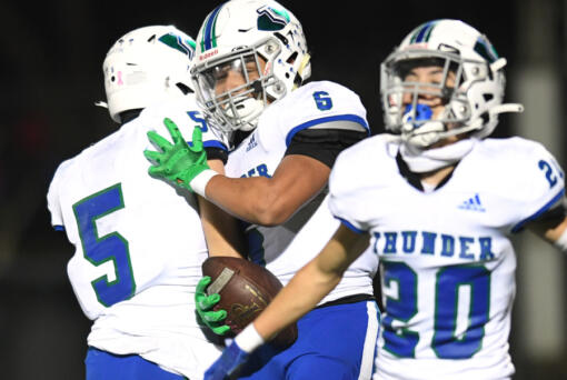 Mountain View senior CJ Hamblin (6) celebrates with teammates after making an interception Friday against Prairie in the 3A Greater St. Helens League game at District Stadium in Battle Ground. The Thunder won 17-14.