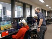 Battle Ground Public Schools Superintendent Denny Waters watches an esports practice at Battle Ground High School.