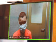 Isaac M Spiekerman, 23, appears in Clark County Superior Court on suspicion of three counts of first-degree assault. Spiekerman is accused of shooting a man in the head during an argument Wednesday morning in Washougal.