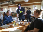 Nicole Kluka serves breakfast to Brian and Leah Trudell at The Diner Vancouver. As fans of diners and midcentury style, the Trudells were excited for their first visit.