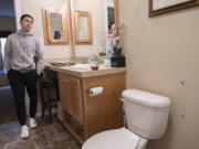 Lorenz Soriano of Vancouver looks over three bullet holes, right, in his bathroom Monday afternoon after Clark County sheriff's deputies fired at a suspect Sunday morning that the agency said was armed with a handgun.