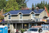 Crews install a new Tesla roof at Dave Miller's Camas home. At top: The glass photovoltaic tiles in a Tesla roof are stronger than standard roofing tiles, according to the company.