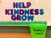 """South Ridge Elementary fourth-graders are growing a """"kindness tree"""" of good deeds they witnessed. Each leaf marks a good deed."""