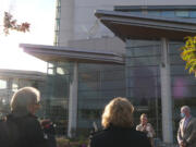Community members gather for the unveiling of a new statue of a dove at PeaceHealth Southwest Medical Center's Firstenburg Tower.