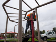 Don Wingate of the city of Washougal repairs an aging play structure at Hamllik Park in Washougal on Friday morning. Washougal city workers are wrapping up work on upgrades to the park, which will include replacing the play structure.
