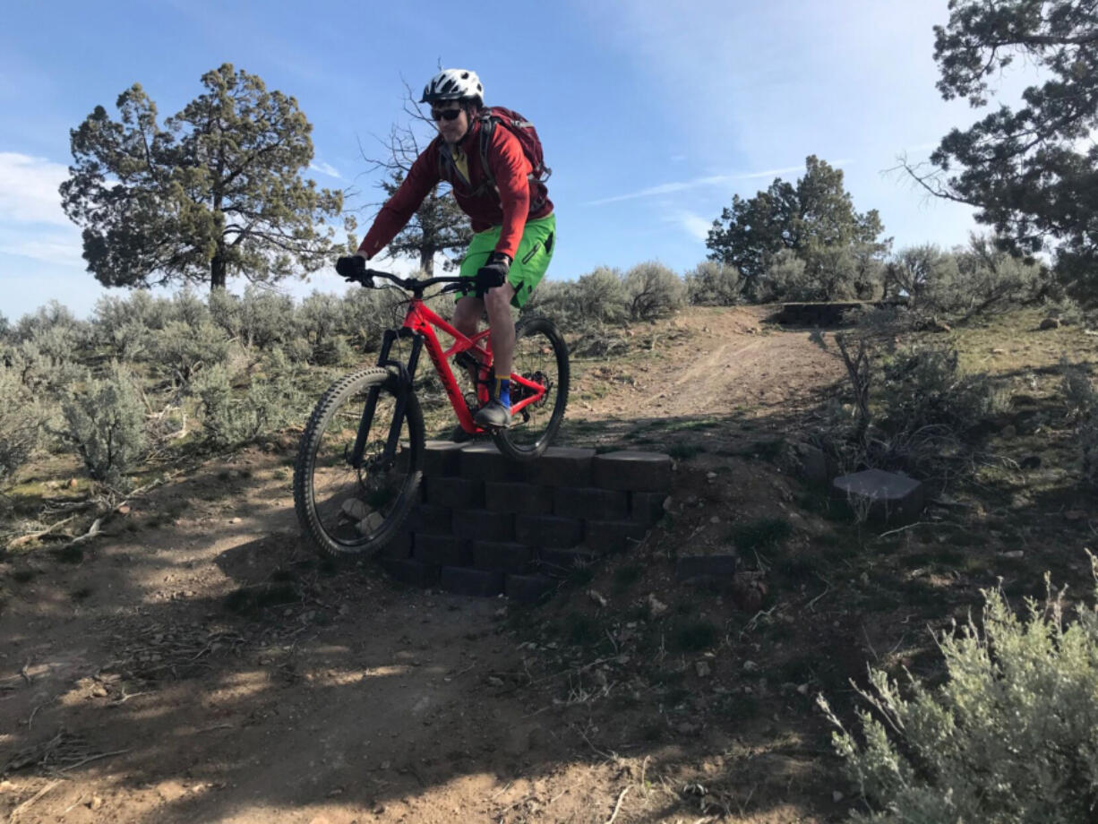 Andrew Williams of Bend, Ore., rides a concrete drop at the Madras East Hills trail system.
