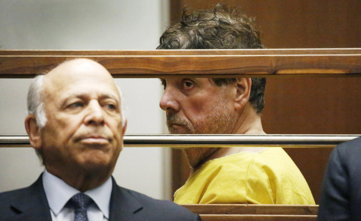 Dr. George Tyndall appears in the Los Angeles Superior courtroom of Judge Teresa Sullivan with his attorneys Leonard B. Levine, left, and Andrew Flier for a bail review hearing July 9, 2019.