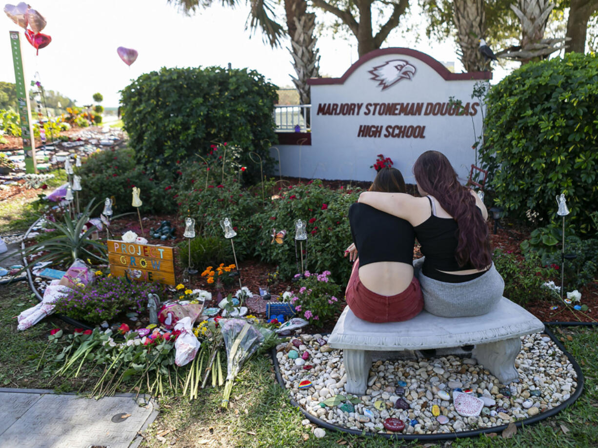 Mourners visit a makeshift memorial outside of Marjory Stoneman Douglas High School in Parkland, Florida, on Feb. 14, 2020, the two-year anniversary of the Parkland shooting that left 17 people dead. The shooting prompted Florida and other states to pass so-called red flag laws. (Matias J.
