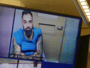 Jessica Prokop/The Columbian Aarondeep Johal, 32, makes a first appearance via video Monday in Clark County Superior Court in an attempted murder and kidnapping case involving his girlfriend.