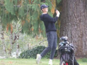 Camas' Eli Huntington hits his tee shot on No. 17 at Lewis River during the 4A district golf tournament on Tuesday, Oct.