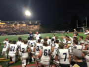 Kelso football coach Steve Amrine addresses his team following a 42-10 win over Evergreen on Friday at McKenzie Stadium.