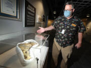 Jeff Stanford at an exhibit of coprolite (fossilized dinosaur droppings) at the Orlando Science Center on Oct. 12, 2021. The center currently has on display more than a dozen poop specimens, including the Guinness World Record holder of the largest fossilized excrement from a carnivore ever found. Just one example of unusual items that have insurance policies to protect them. (Stephen M.