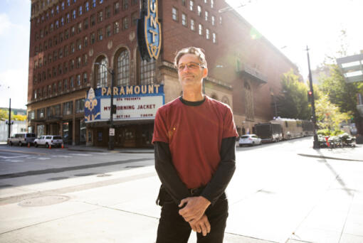 Christopher Smith is a stage hand working on setting up a show at the Paramount Theater in Seattle on Friday, Oct. 1, 2021. He is back to work as the pandemic lifts -- but the end of benefits isn't what made that happen.