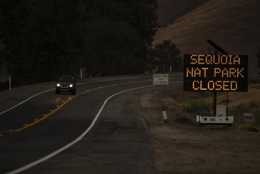 A sign warns motorists of the closure of Sequoia National Park as the KNP Complex fire threatens the area on Sept. 15, 2021 in Three Rivers, California.