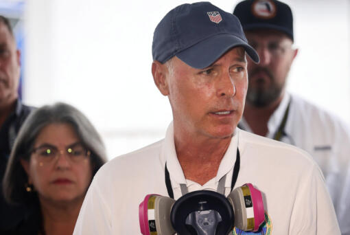 Surfside Mayor Charles Burkett gives his remarks during the daily morning press conference outside Miami-Dade County's operational center on Sunday, July 11, 2021.
