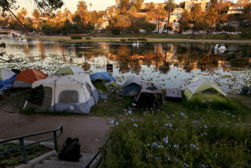 A homeless encampment on the banks of Echo Park Lake in Los Angeles, Dec. 30, 2020. Countless homeless people shelter in nooks and crannies in an urban landscape covered in graffiti and trash as the city struggles with reduced tax revenues and budgets.