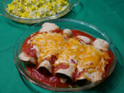 Chicken enchiladas with esquites (sauteed corn).
