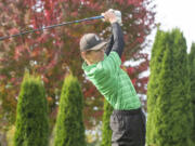 Woodland junior Dane Huddleston tees off on Day 1 of the 2A District 4 Boys Golf Tournament at Riverside Golf Course in Chehalis on Oct. 20, 2021.
