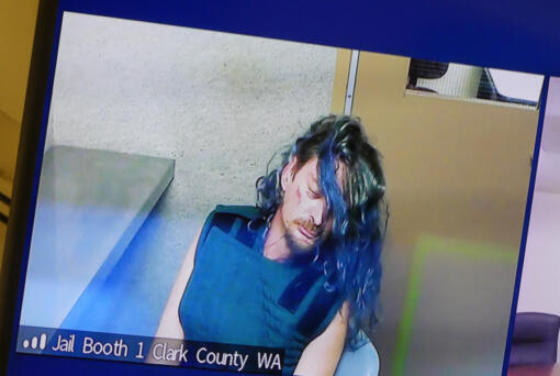Jesse Roehm, 44, makes a first appearance via video Wednesday morning in Clark County Superior Court in a shooting Tuesday evening at the Alder Creek Apartments and Townhomes in east Vancouver. No one was wounded.