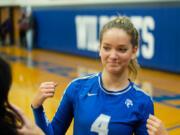 La Center volleyball senior Summer Senske flexes as she talks to coach Cymany O'Brien before a match.