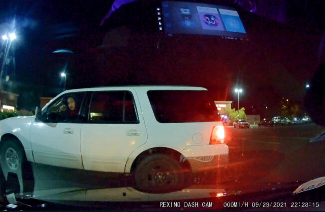 A dash camera image of Kfin Karuo allegedly pointing a gun at a man Sept. 29 in an east Vancouver parking lot. Clark County sheriff's deputies pursued Karuo on Sunday in connection with the alleged assault before fatally shooting him after the agency said he pointed a gun at deputies.
