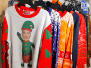 Some of the many Christmas sweaters at the UglyChristmasSweater.com warehouse in Commerce Township, Michigan on Tuesday, October 12, 2021.Fred and Mark Hajjar, co-founders of UglyChristmasSweater.com, have a large supply of these type of sweaters and other items stuck on freighters off the coast of California.