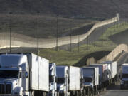 Trucks line up to cross the border with the United States at Otay Mesa Commercial Port of Entry in Tijuana, Mexico on Jan. 22, 2018.