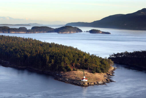 Steve Ringman/The Seattle Times      The lighthouse on the northern tip of Patos Island, with Sucia Island and Orcas Island in the distance, looks toward Canada across The Salish Sea.