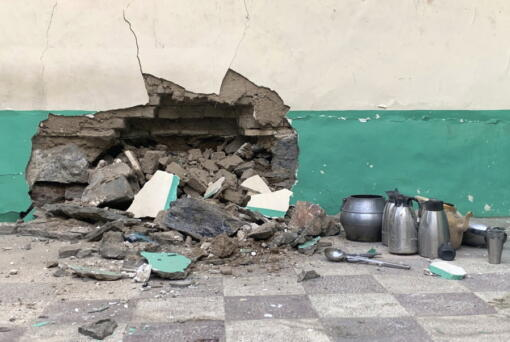 Damaged wall of a mosque is seen following a suicide bombers attack in the city of Kandahar, southwest Afghanistan, Friday, Oct. 15, 2021.  Suicide bombers attacked a Shiite mosque in southern Afghanistan that was packed with worshippers attending Friday prayers, killing several people and wounding others, according to a hospital official and a witness.