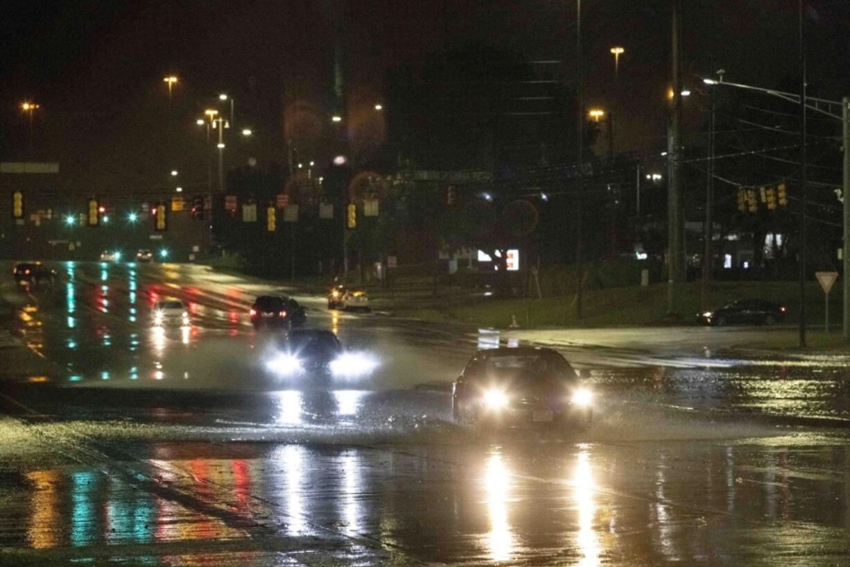 Car travel through floodwaters on Montgomery highway Wednesday, Oct. 6, 2021, near the Riverchase Galleria complex in Birmingham, Ala.
