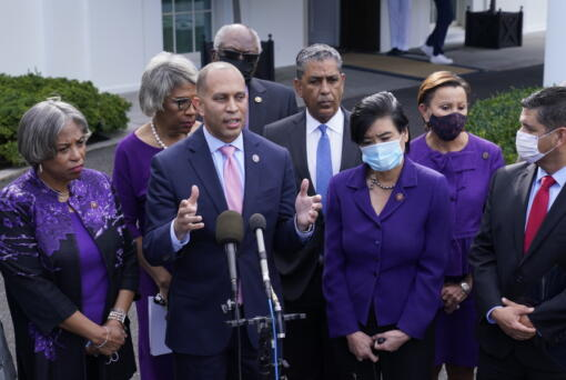 Rep. Hakeem Jeffries, D-N.Y., standing with other House Democrats, talks to reporters outside the West Wing of the White House in Washington, Tuesday, Oct. 26, 2021, following a meeting with President Joe Biden to work out details of the Biden administration's domestic agenda.