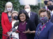 Rep. Pramila Jayapal, D-Wash., the chair of the Congressional Progressive Caucus, center, along with other lawmakers, talks with reporters outside the West Wing of the Washington, Tuesday, Oct. 19, 2021, following their meeting with President Joe Biden. Jayapal is joined by from left, Rep. Katherine Clark, D-Mass., Rep. Debbie Dingell, D-Mich., Rep. Mark Pocan, D-Wis., Rep. Barbara Lee, D-Calif., and Rep. Ritchie Torres, D-New York.